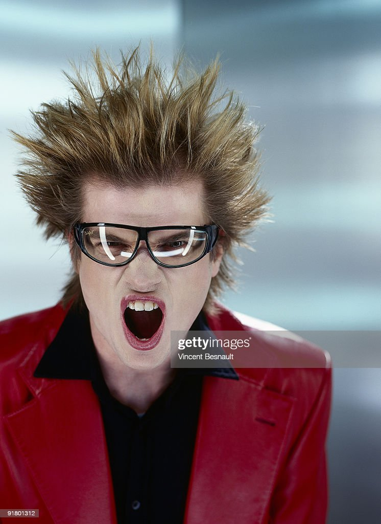 Man with eyeglasses and spiked hair : Stock Photo