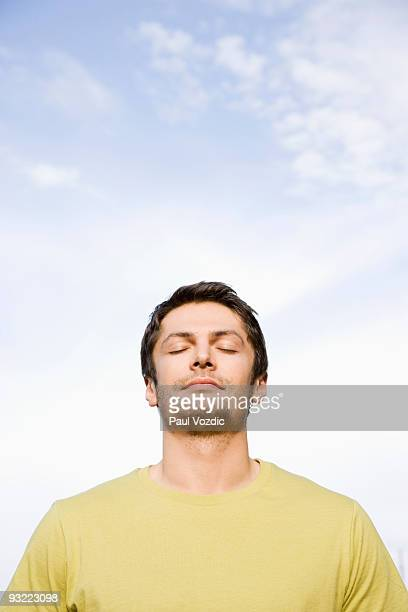 Man with eyes closed and sun on face