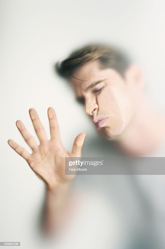 man with face pressed against glass : Stock Photo