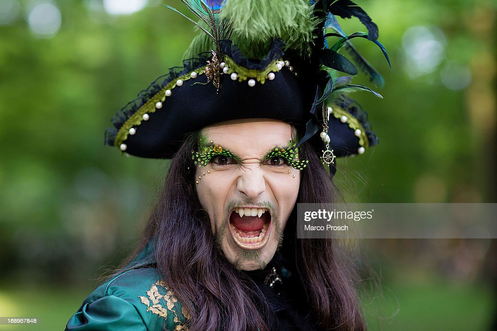A man with fake vampire teeth wearing a pirate's costume attends the traditional park picnic on the first day of the annual Wave-Gotik Treffen, or Wave and Goth Festival, on May 17, 2013 in Leipzig, Germany. The four-day festival, in which elaborate fashion is a must, brings together over 20,000 Wave, Goth and steam punk enthusiasts from all over the world for concerts, readings, films, a Middle Ages market and workshops.