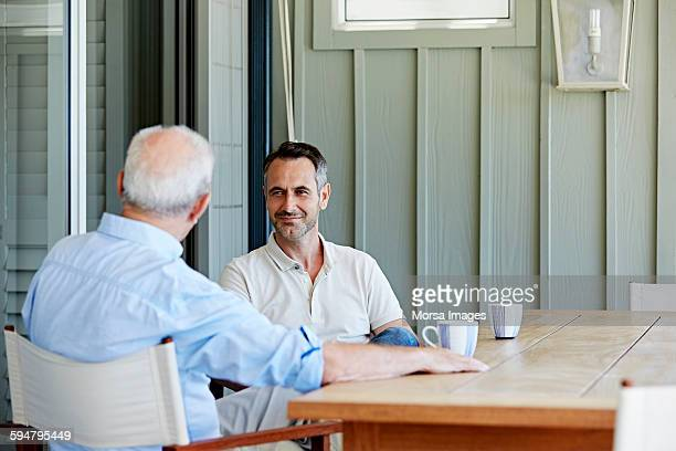 Man with father spending leisure time