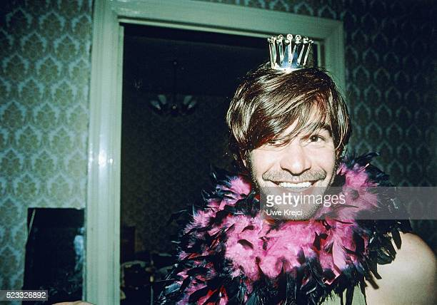 Man with feather boa and crown