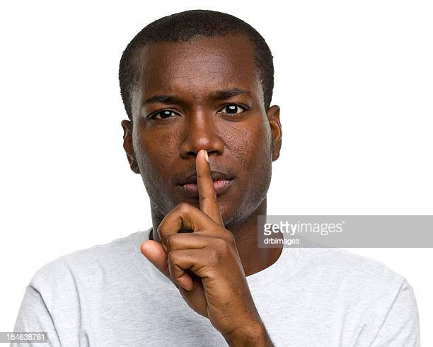 Man With Finger to Lips