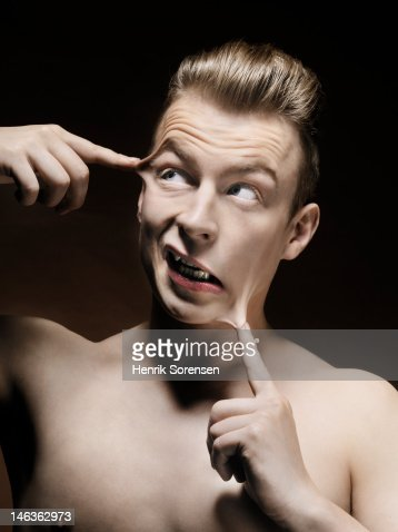man with fingers glued to his head : Stock Photo