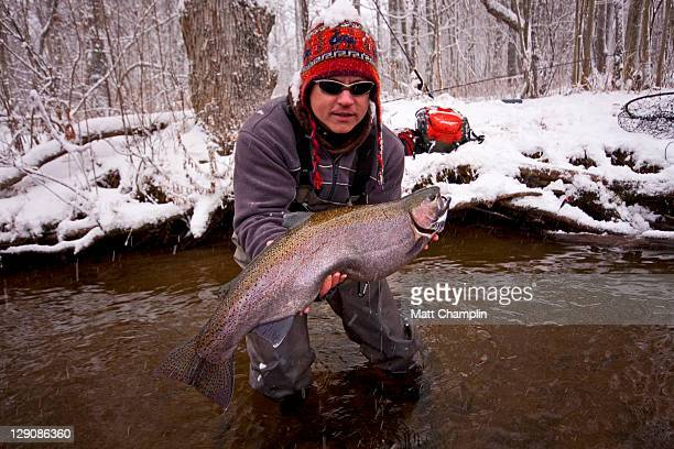 Man with fish in winter