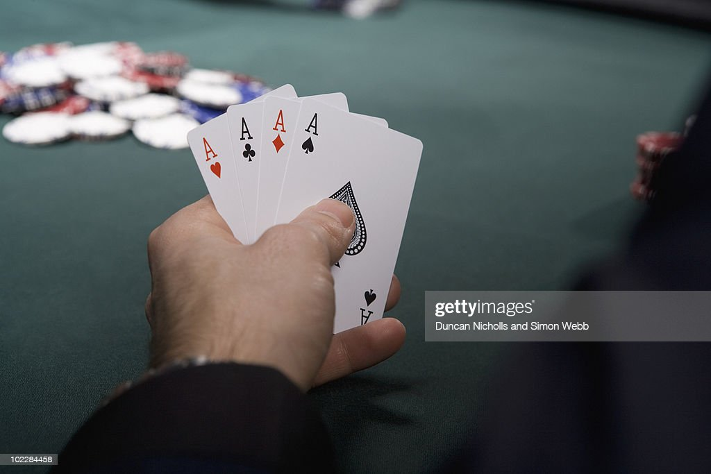 Man with four aces in casino : Stock Photo