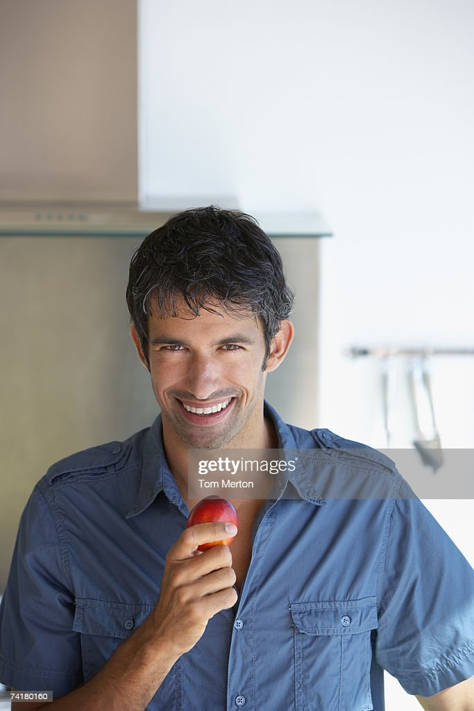 Man with fruit : Stock Photo