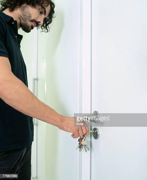 Man with full beard locking door