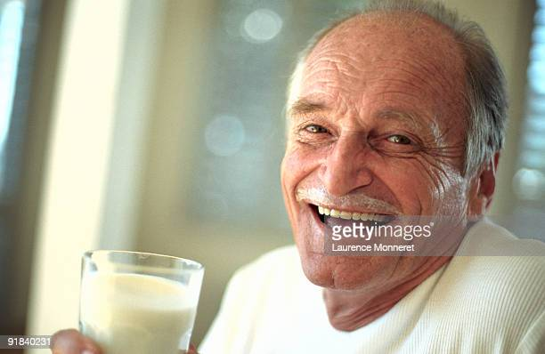 Man with glass of milk