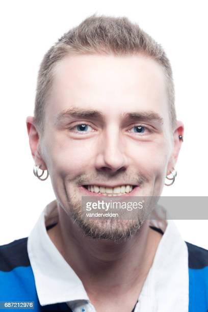 Man with goatee beard and earrings