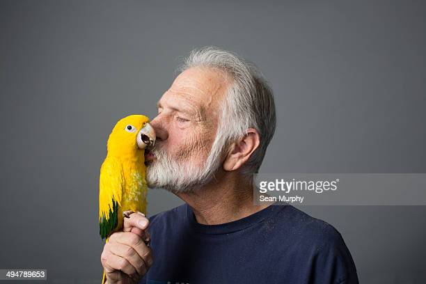 Man with Golden Conure (Guaruba guarouba)