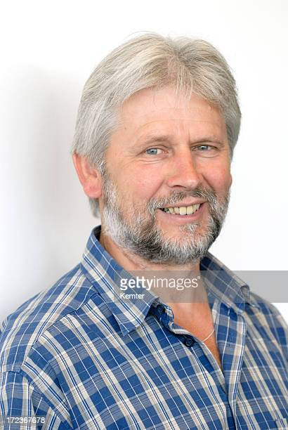 man with grey hair smiling
