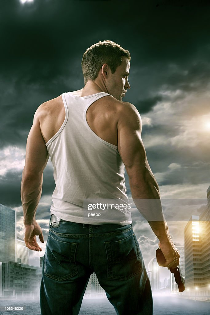 man with gun in city : Stock Photo