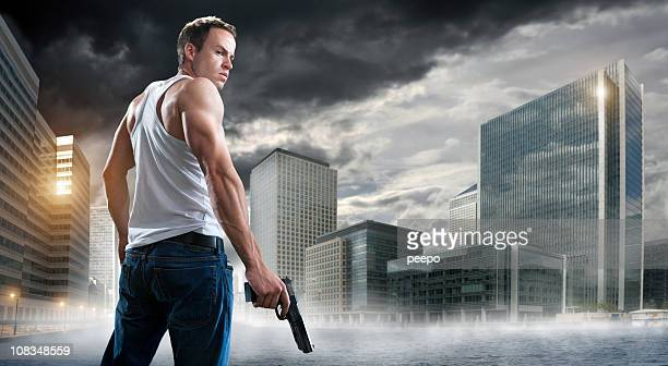 man with gun in city