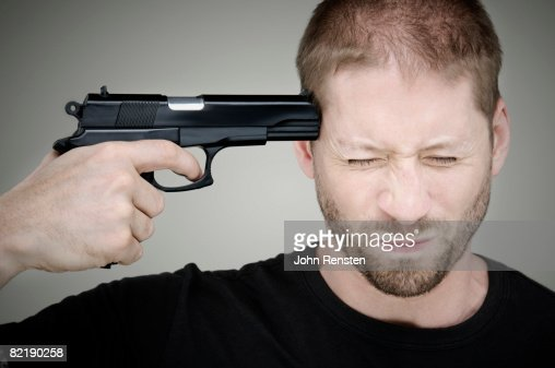 man with gun to his head : Stock Photo