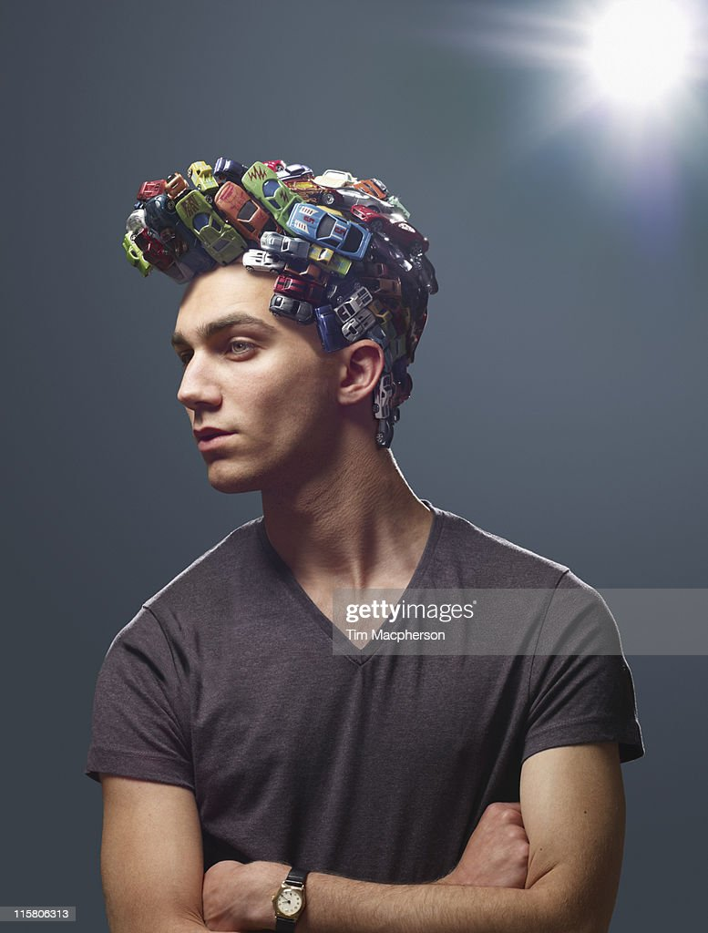 Man with hair made of toy cars