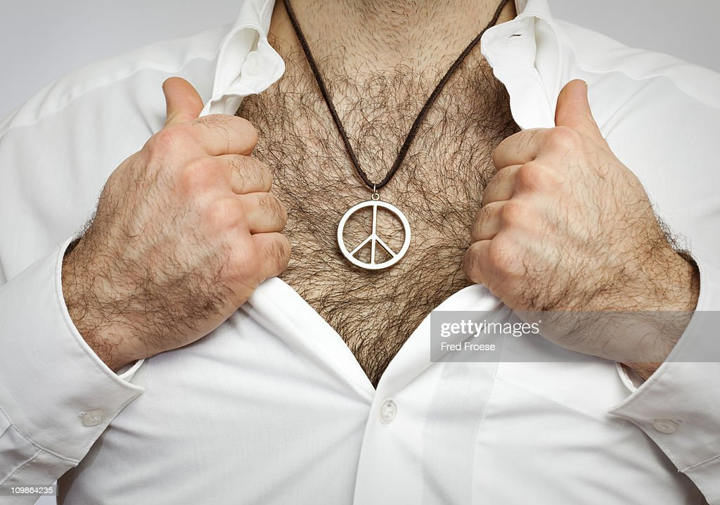 Man with hairy chest wearing Peace symbol