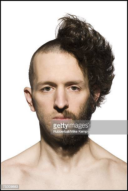 Man with half shaved head and beard