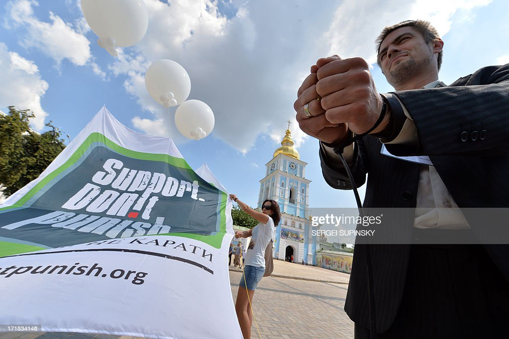 A man with handcuffs attends on June 26, 2013 the 'Support. Don't Punish' public street event in the center of the Ukrainian capital of Kiev. People who use drugs legally or illegaly, their parents and medical workers protest against cruel and senseless state policies, which severely affect the lives of tens of thousands convicted for possessing a small amount of drug substances for personal use. Protesters called for an end to the blossoming 'drug corruption' in the law enforcement structures. The protest was organized on the occasion of the International Day against Drug Abuse and illicit Trafficking, as well as the International Day in support of Victims of Torture within the framework of the global 'Support. Don't punish' campaign to the held at the same time in 26 capitals and big cities of the world.