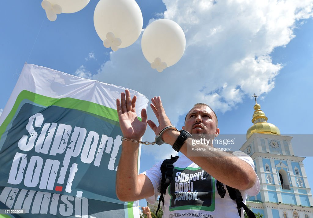 A man with handcuffs releases a balloon carrying a syringe on June 26, 2013 during the 'Support. Don't Punish' public street event in the center of the Ukrainian capital of Kiev. People who use drugs legally or illegaly, their parents and medical workers protest against cruel and senseless state policies, which severely affect the lives of tens of thousands convicted for possessing a small amount of drug substances for personal use. Protesters called for an end to the blossoming 'drug corruption' in the law enforcement structures. The protest was organized on the occasion of the International Day against Drug Abuse and illicit Trafficking, as well as the International Day in support of Victims of Torture within the framework of the global 'Support. Don't punish' campaign to the held at the same time in 26 capitals and big cities of the world.