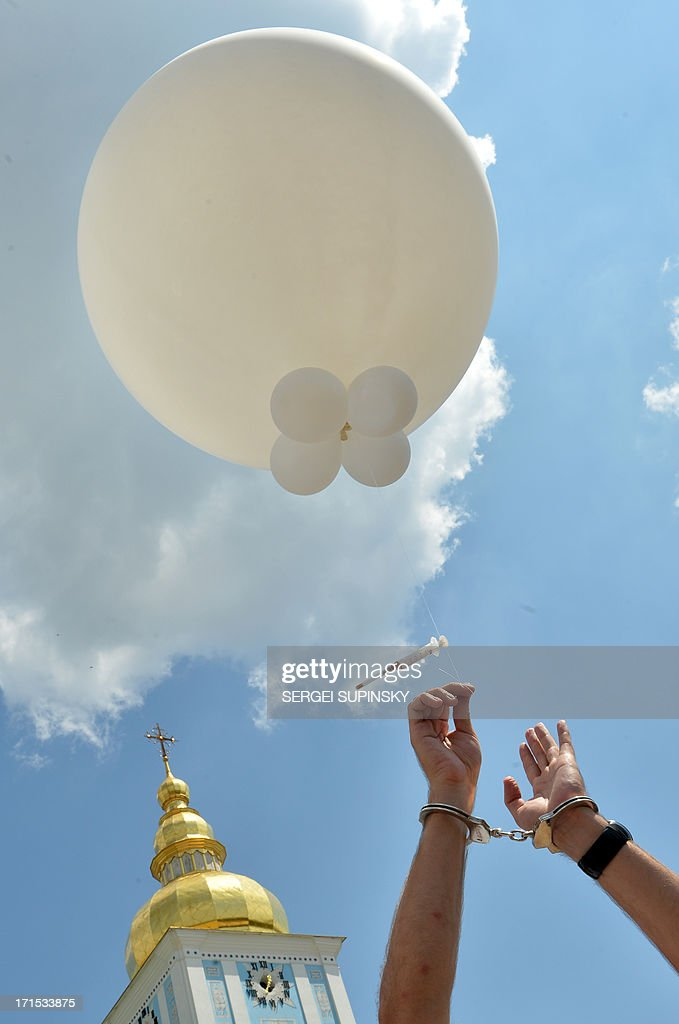 A man with handcuffs releases a balloon with a syringe on June 26, 2013 during the 'Support. Don't Punish' public street event in the center of the Ukrainian capital of Kiev. People who use drugs legally or illegaly, their parents and medical workers protest against cruel and senseless state policies, which severely affect the lives of tens of thousands convicted for possessing a small amount of drug substances for personal use. Protesters called for an end to the blossoming 'drug corruption' in the law enforcement structures. The protest was organized on the occasion of the International Day against Drug Abuse and illicit Trafficking, as well as the International Day in support of Victims of Torture within the framework of the global 'Support. Don't punish' campaign to the held at the same time in 26 capitals and big cities of the world.