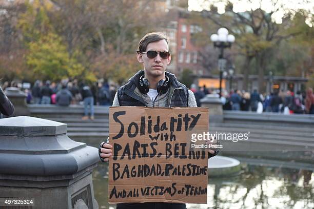 Man with handlettered sign expressing solidarity with places victimized by terror attacks A day that began with a rally at Washington Square Park...