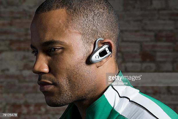 Man with hands free device