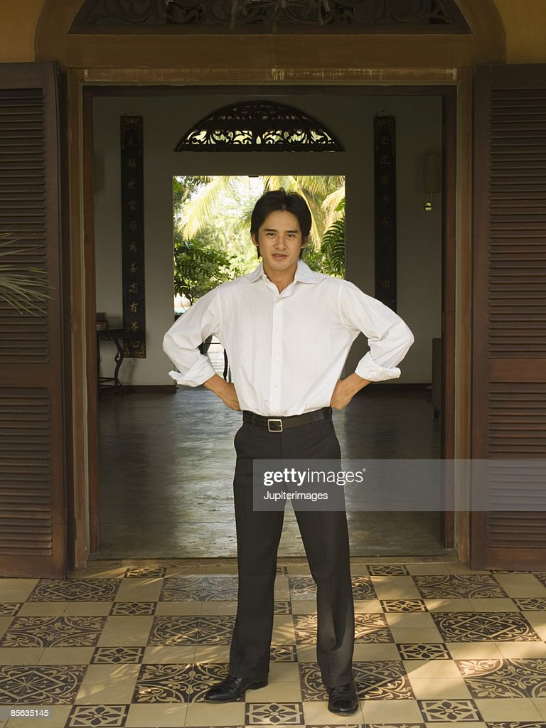 Man with hands on hips : Stock Photo