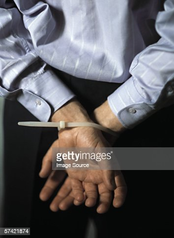 Man with hands tied