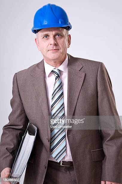 Man with hard hat and file