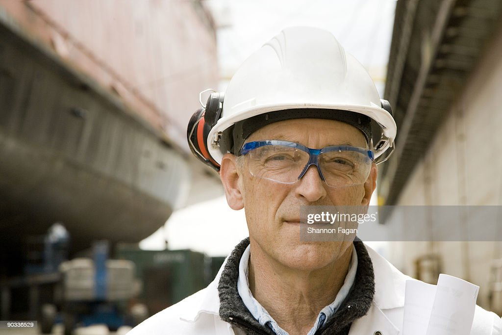 Man With Hard Hat and Protective Glasses
