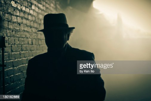 Man with hat and misty in background