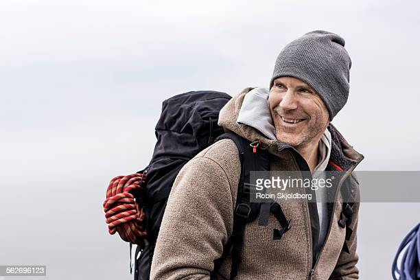 Man with hat and rucksack laughing