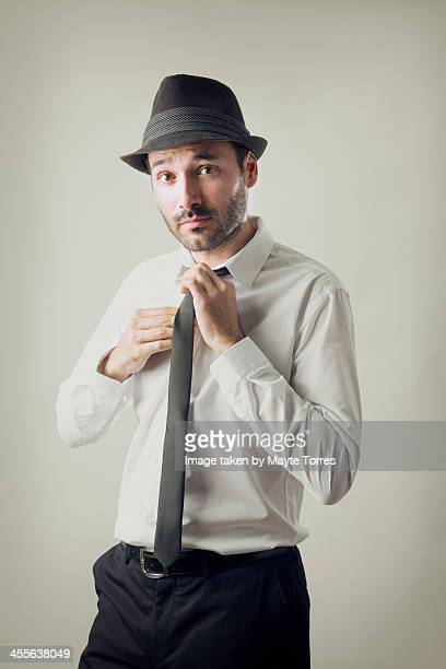 Man with hat and tie