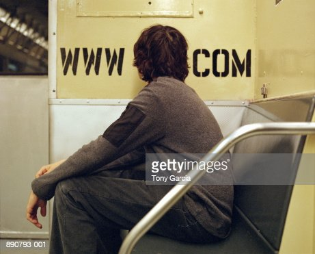 Man with head between internet address on subway car wall : Stock Photo