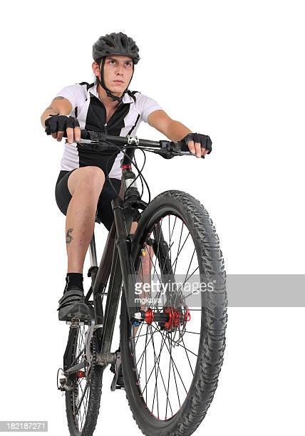 Man with head gear riding on mountain bike