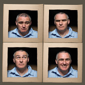 Man with head in boxes pulling faces