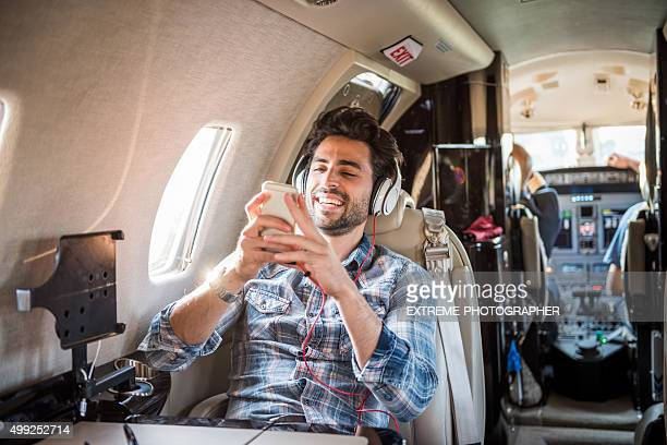 Man with headphones in private jet airplane