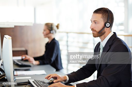 Man with headset doing phone support