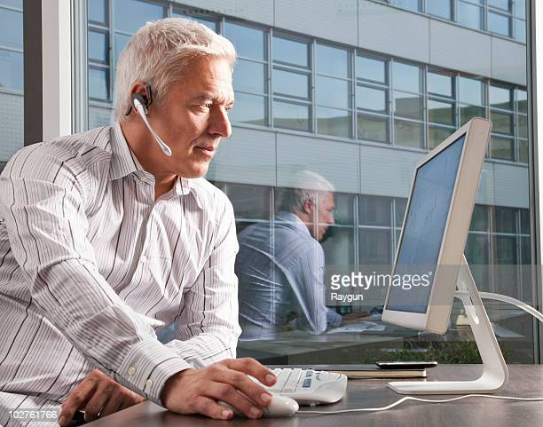 Man with headset working on computer