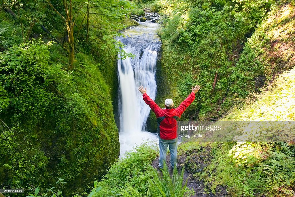 A Man With His Arms Stretched Upwards While Looking At Middle Oneonta Falls In Columbia River Gorge National Scenic Area