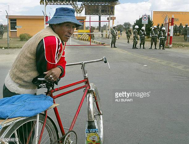 A man with his bicycle offers his services for the transportation of goods or people in front of the entrance gate of the international airport...