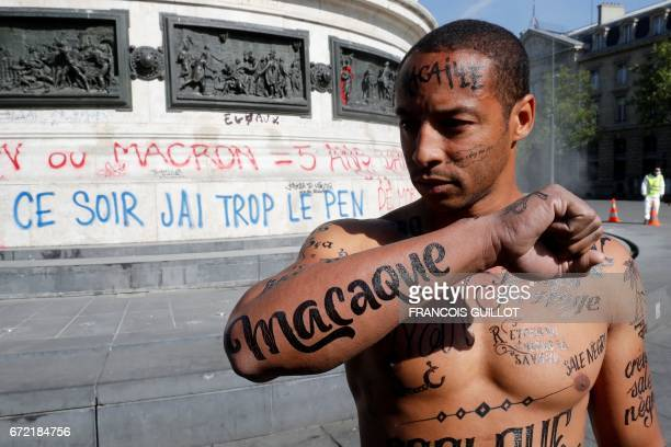 TOPSHOT A man with his body covered with racist insults poses during an event organized by the Conseil Representatif des Associations Noires de...