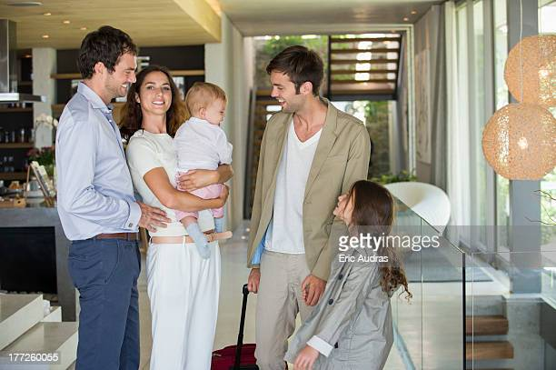 Man with his daughter arriving from holiday at his friends home