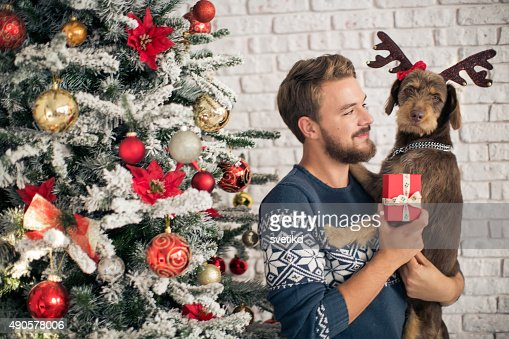 Man with his dog hugging for christmas.