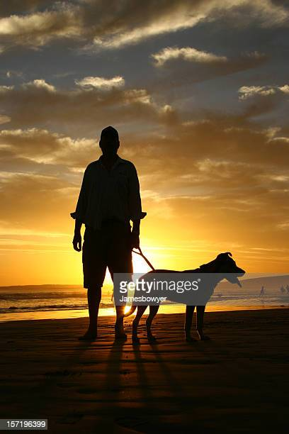 Man with his Dog on beach