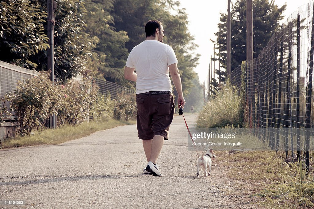 Man with his dog : Stock Photo