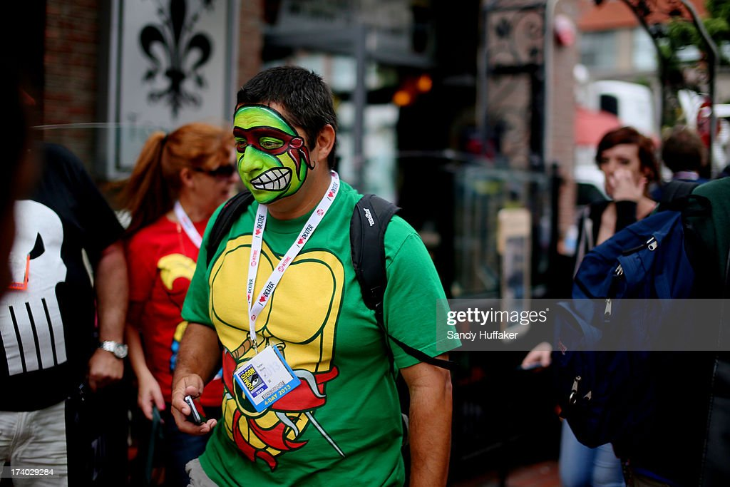 A man with his face painted as a Teenage Mutant Ninja Turtle walks down Fifth Avenue during Comic Con at the San Diego Convention Center on July 19, 2013 in San Diego, California. Comic Con International Convention is the world's largest comic and entertainment event and hosts celebrity movie panels, a trade floor with comic book, science fiction and action film-related booths, as well as artist workshops and movie premieres.
