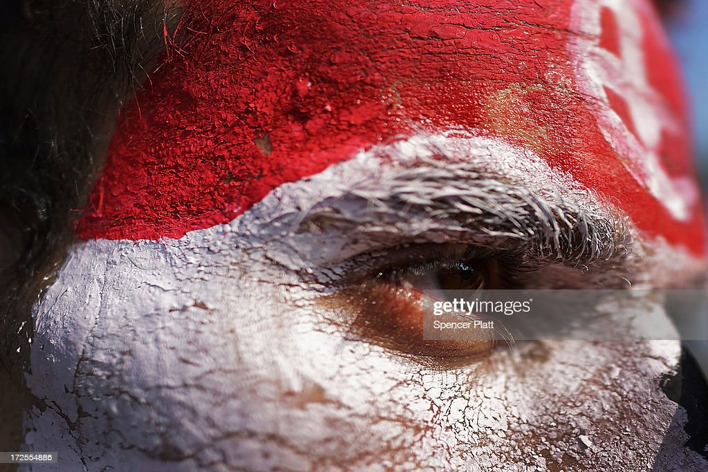 A man with his face painted the colors of the Egyptian flag looks out as thousands of Egyptian protesters celebrate in Tahrir Square as the deadline given by the military to Egyptian President Mohammed Morsi passes on July 3, 2013 in Cairo, Egypt. The president gave a defiant speech last night and vowed to stay in power despite the military threats. As unrest spreads throughout the country, at least 23 people were killed in Cairo on Tuesday and over 200 others were injured. It has been reported that the military has taken over the state television.
