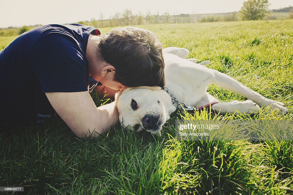 Man with his pet dog outdoors : Stock Photo